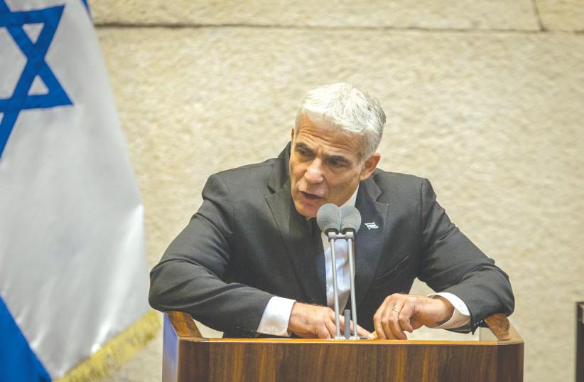 YESH ATID Party chairman MK Yair Lapid speaks in the Knesset in August. (photo credit: OREN BEN HAKOON/FLASH90)