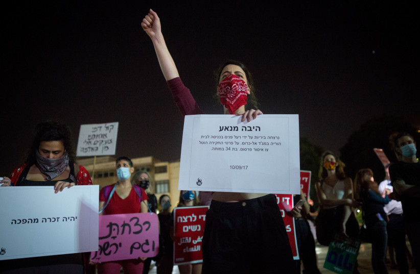 Activists protest against recent cases of violence against women at Habima square in Tel Aviv on October 21, 2020.  (photo credit: MIRIAM ALSTER/FLASH90)