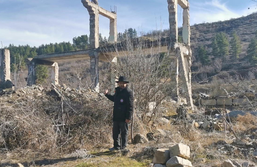 Rabbi Zamir Isayev is seen in front of the destroyed remnants of a hospital in Zangilan, a city liberated by Azerbaijan from Armenia. (photo credit: ZAMIR ISAYEV)