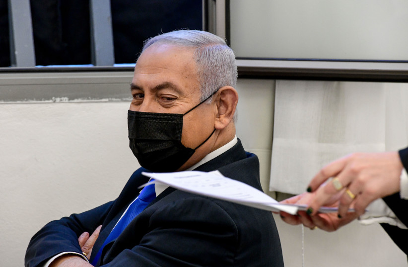 Israeli prime minister Benjamin Netanyahu seen as he arrives for a court hearing at the District Court in Jerusalem on February 8, 2021, PM Netanyahu is on trial on criminal allegations of bribery, fraud and breach of trust. (photo credit: REUVEN KASTRO/POOL)