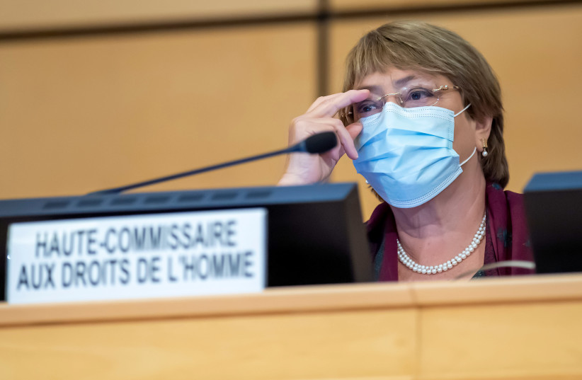 United Nations' High Commissioner for Human Rights Michelle Bachelet adjusts her glasses during the opening of 45th session of the Human Rights Council, at the European UN headquarters in Geneva, Switzerland September 14, 2020. (photo credit: MARTIAL TREZZINI/POOL VIA REUTERS)