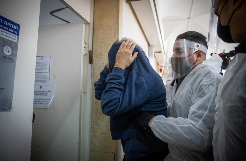 Yuval Carmi, a psychologist suspected of committing sexual offenses on at least one of his patients is brought in for a court hearing at the Jerusalem Magistrate's Court on January 28, 2021.  (photo credit: YONATAN SINDEL/FLASH 90)