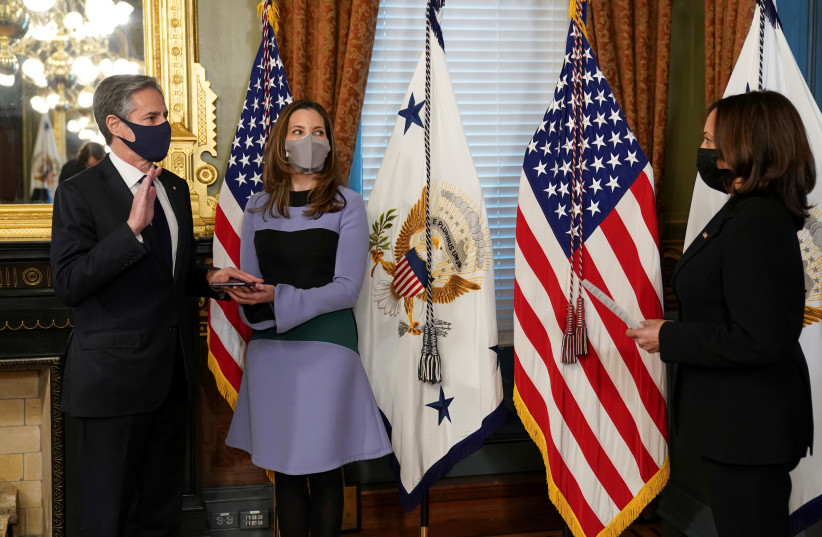 US Secretary of State Antony Blinken, with his wife Evan Ryan at his side, is ceremonially sworn in by Vice President Kamala Harris at the White House on January 27. (photo credit: KEVIN LAMARQUE/REUTERS)