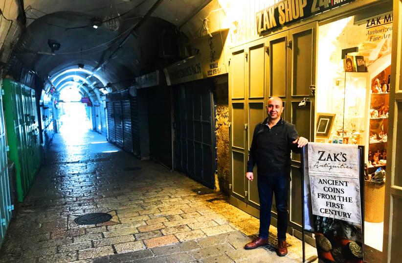 Zak Mishirky outside his antique gift shop in the Old City of Jerusalem. (photo credit: Courtesy)