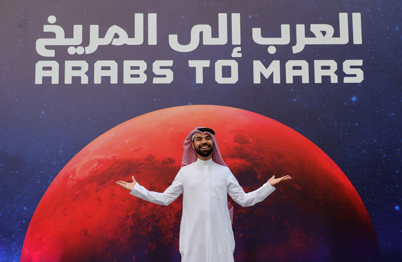 An attendee poses as he arrives to an event to mark Hope Probe's entering the orbit of Mars, in Dubai, United Arab Emirates, February 9, 2021.  (photo credit: REUTERS/CHRISTOPHER PIKE)