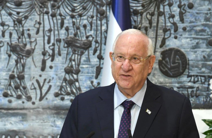 President Reuven Rivlin awards the 2021 Wolf Prize. (photo credit: MARK NEYMAN/GPO)