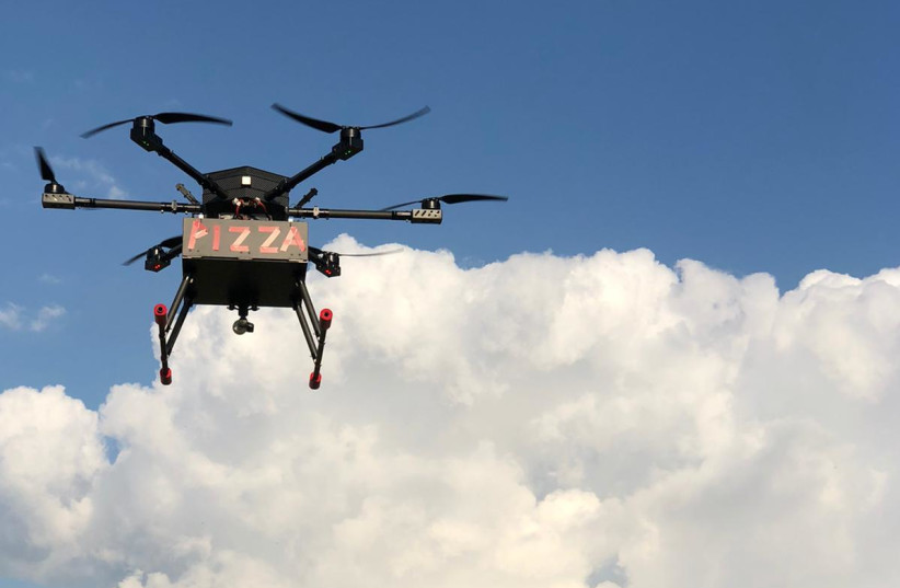 A drone delivers pizza in a pilot project commissioned by Israel's government. (photo credit: CANDO)