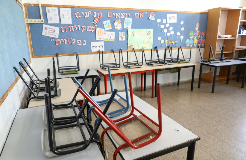 A school classroom is seen empty in Jerusalem's Beit Hakerem. (photo credit: MARC ISRAEL SELLEM/THE JERUSALEM POST)