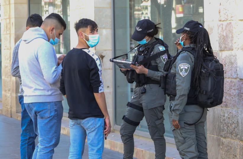 Police are seen on Jerusalem's Jaffa Street amid the coronavirus pandemic, on February 10, 2021. (photo credit: MARC ISRAEL SELLEM/THE JERUSALEM POST)