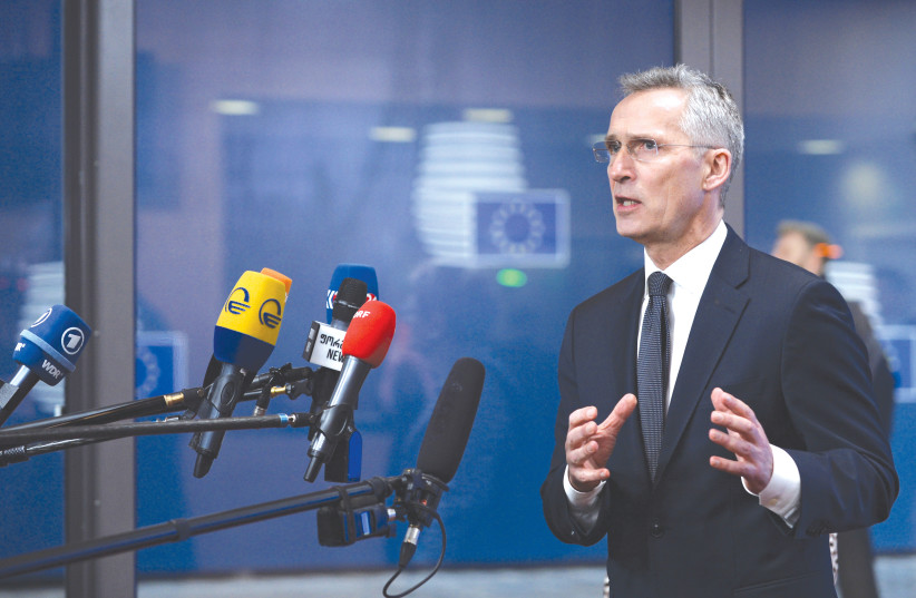 NATO SECRETARY-GENERAL Jens Stoltenberg holds a news conference to discuss ways to try to save the Iran nuclear deal, in Brussels, Belgium, last month. (photo credit: JOHANNA GERON/REUTERS)