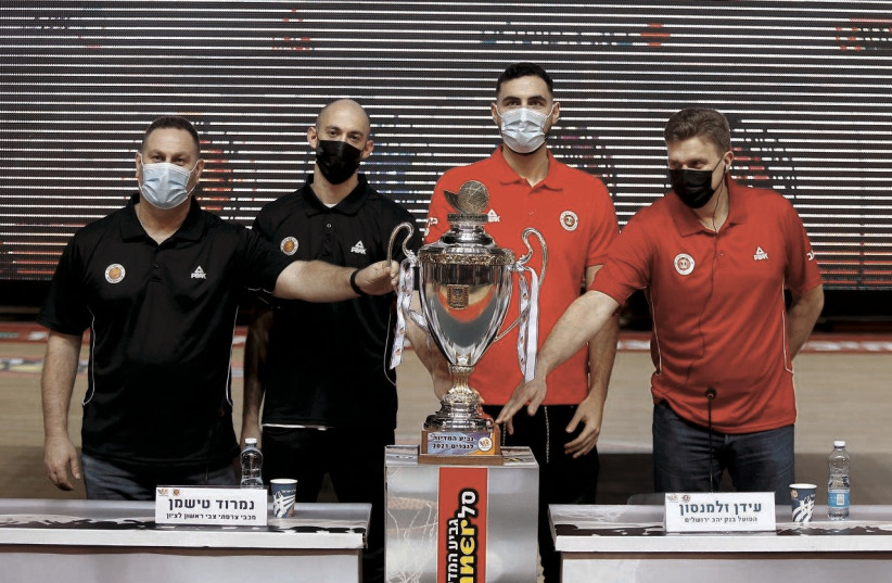 AHEAD OF their State Cup semifinal clash tonight, (from left) Maccabi Rishon Lezion coach Guy Goodes and guard Nimrod Tishman pose with the trophy next to Hapoel Jerusalem center Idan Zalmanson and coach Dainius Adomaitis. (photo credit: ISRAEL BASKETBALL ASSOCIATION/COURTESY)