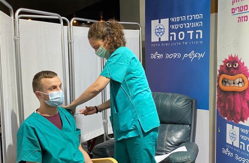 Medical personnel at Hadassah-University Medical Center is inoculated (photo credit: HADASSAH SPOKESPERSON)