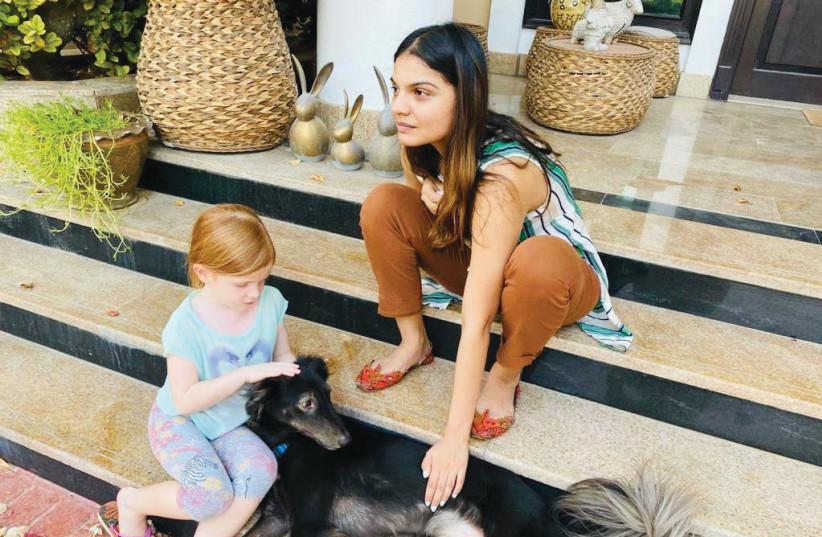 NYLA KHAN works with a homeschooled child. (photo credit: COURTESY NYLA KHAN)