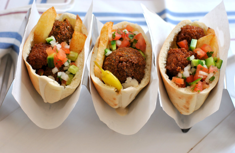 Three falafel and salad-filled pitas. (photo credit: PASCALE PEREZ-RUBIN)