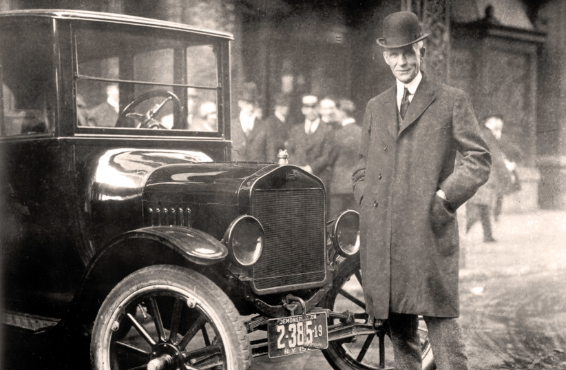 HENRY FORD with a Model T, 1921. One can still easily purchase his century-old diatribe 'The International Jew.' (photo credit: Wikimedia Commons)