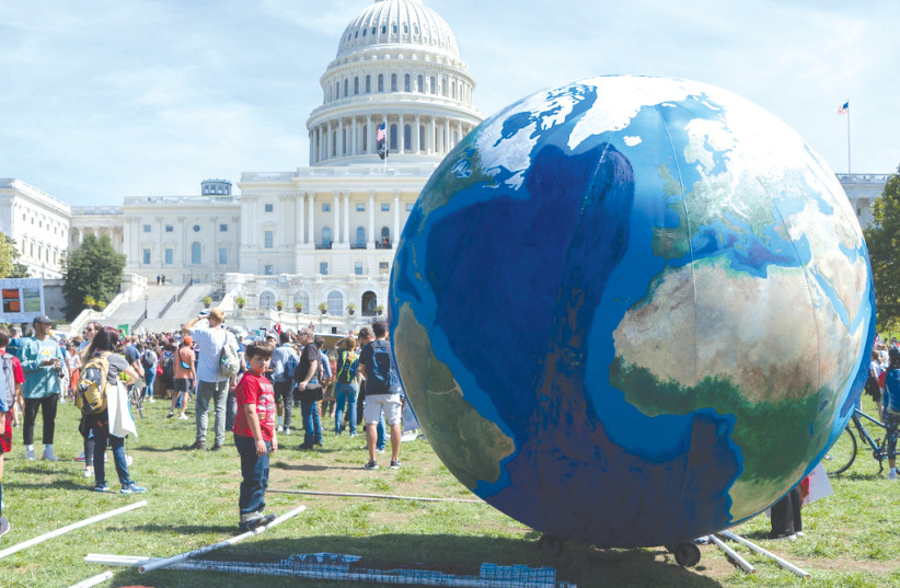 A PROTEST about the climate crisis outside the US Capitol in 2019. (credit: VICTORIA PICKERING/CREATIVE COMMONS)