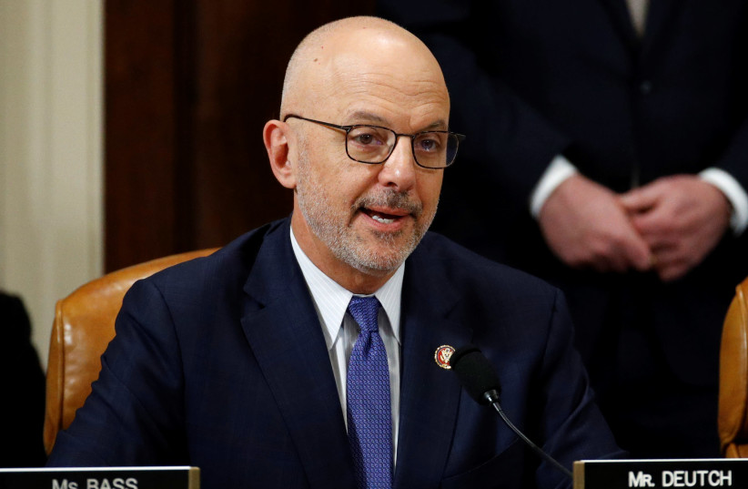Rep. Ted Deutch, D-Fla., votes to approve the second article of impeachment against President Donald Trump during a House Judiciary Committee meeting on Capitol Hill, in Washington. (photo credit: PATRICK SEMANSKY/POOL VIA REUTERS)