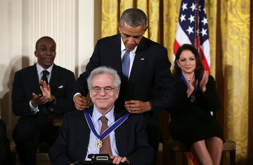 Violinist Itzhak Perlman, seen here receiving the US Presidential Medal of Freedom from President Barack Obama in November 2015, was among those participating in a Feb. 3, 2021, kickoff event for Jewish Disability Advocacy Month.  (photo credit: ALEX WONG/GETTY IMAGES/JTA)
