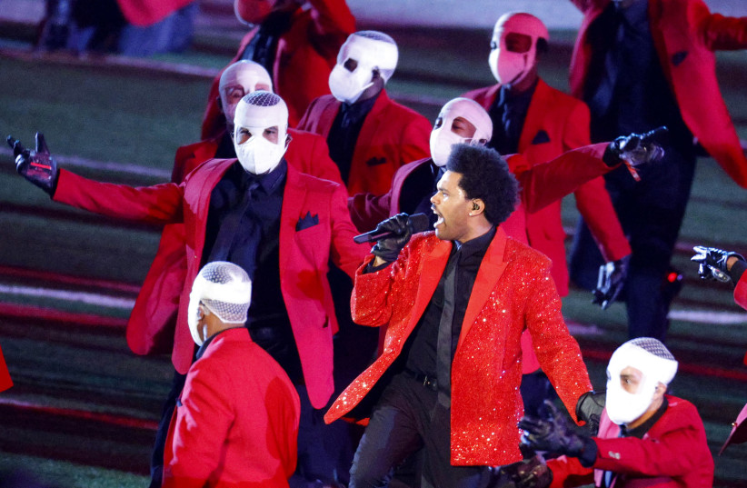 The Weeknd performs during the halftime show (photo credit: REUTERS)