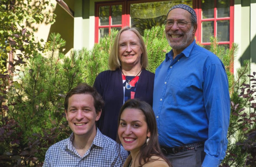 Rabbi Ed Stafman poses with his family in an undated campaign photo in Bozeman, Mont., in 2020. (Ed Stafman campaign) (photo credit: ED STAFMAN CAMPAIGN)