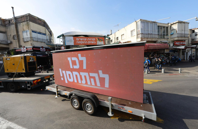 A truck with an electric sign calls on Tel Aviv residents to get vaccinated (photo credit: Courtesy)