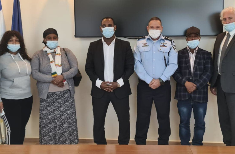 Deputy Interior Security Minister Gadi Yevarkan (C) with Police Chief Kobi Shabtai and members of the Tekah family (photo credit: POLICE SPOKESPERSON'S UNIT)