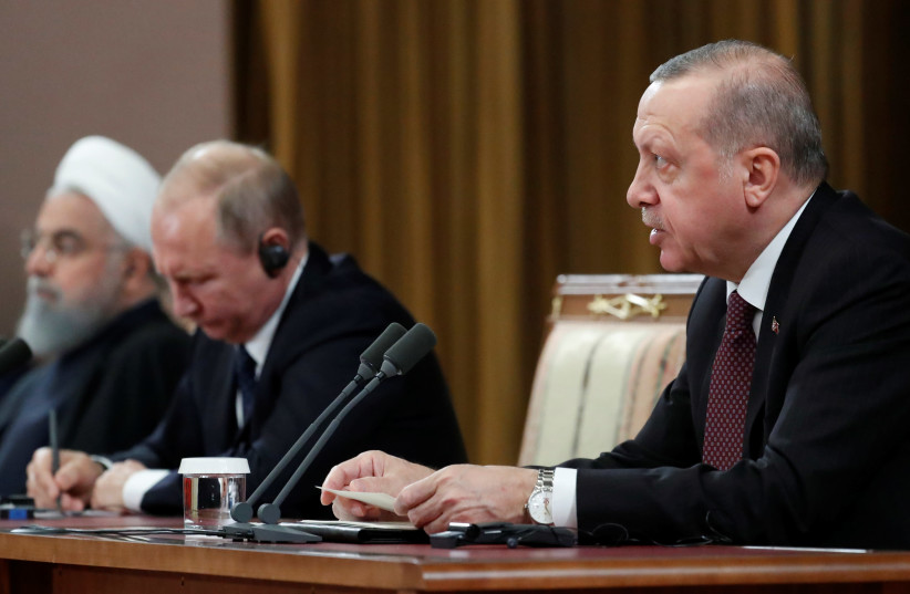 Russian President Vladimir Putin, Iranian President Hassan Rouhani and Turkish President Recep Tayyip Erdogan attend a news conference, after a meeting in the Black sea resort of Sochi (photo credit: SERGEI CHIRIKOV/POOL VIA REUTERS)
