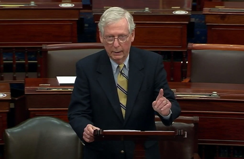 US Senate Minority Leader Mitch McConnell (R-KY) speaks about former US president Donald Trump, accusing him of dereliction of duty, immediately after the US Senate voted to acquit Trump by a vote of 57 guilty to 43 not guilty, short of the 2/3s majority needed to convict, during the fifth day of th (photo credit: US SENATE TV/HANDOUT VIA REUTERS)