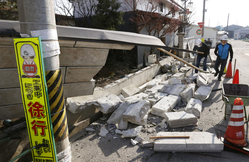 A collapsed wall by a strong earthquake is pictured in Kunimi, Fukushima Prefecture, Japan on February 14, 2021 in this photo taken by Kyodo. (photo credit: KYODO/VIA REUTERS)