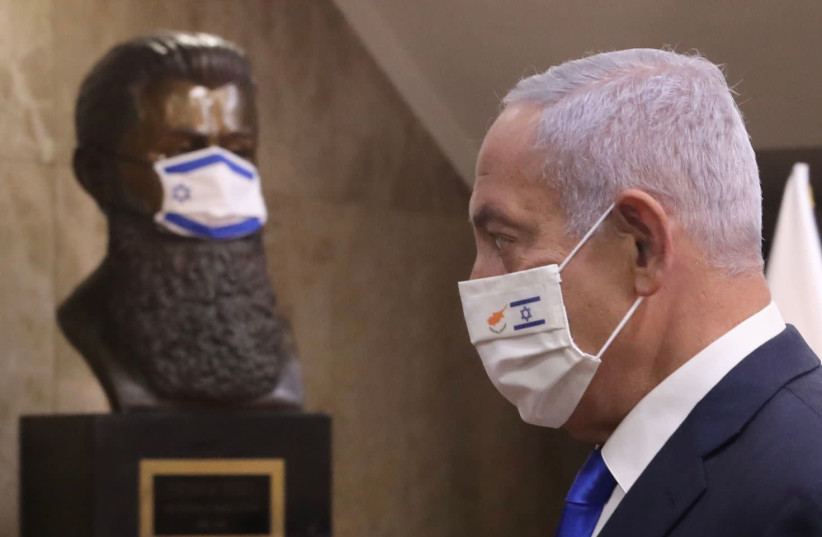 Prime Minister Benjamin Netanyahu (R) in front of a bust of Theodor Herzl. Both are wearing COVID-19 masks.  (photo credit: MARC ISRAEL SELLEM)