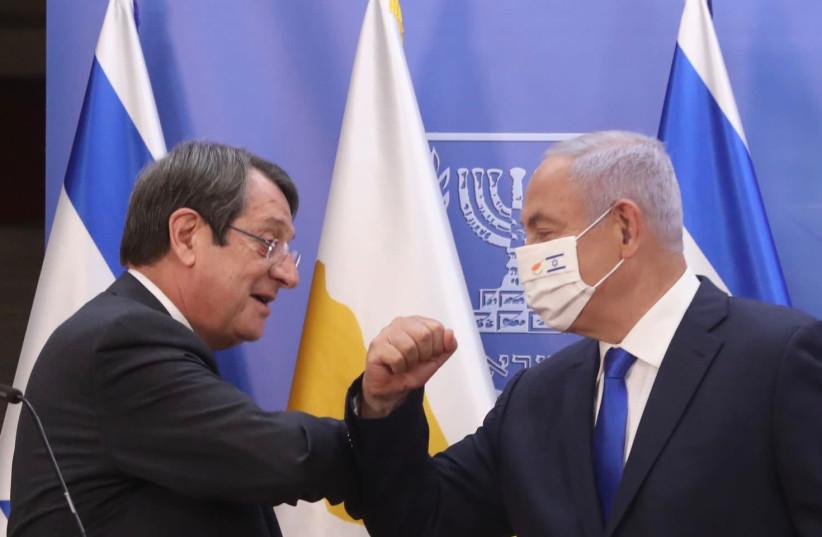 Cypriot President Nicos Anastasiades (R) with Prime Minister Benjamin Netanyahu (R)  (photo credit: MARC ISRAEL SELLEM)