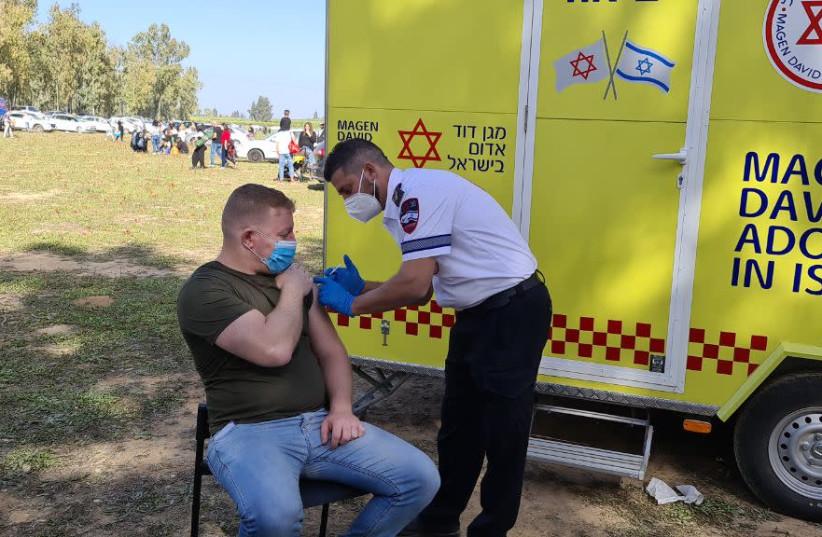 Magen David Adom coronavirus vaccination trailer in Shokeda Forest. (photo credit: MAGEN DAVID ADOM)