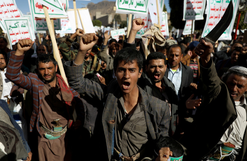 Houthi supporters shout slogans during a rally against the United States' designation of Houthis as a foreign terrorist organization, in Sanaa, Yemen January 25, 2021 (photo credit: REUTERS/KHALED ABDULLAH)