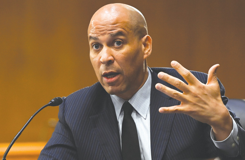 US Senator Cory Booker (D-NJ) speaks during a Senate Environment and Public Works Committee hearing on Capitol Hill in Washington earlier this month. (photo credit: BRANDON BELL/REUTERS/POOL)