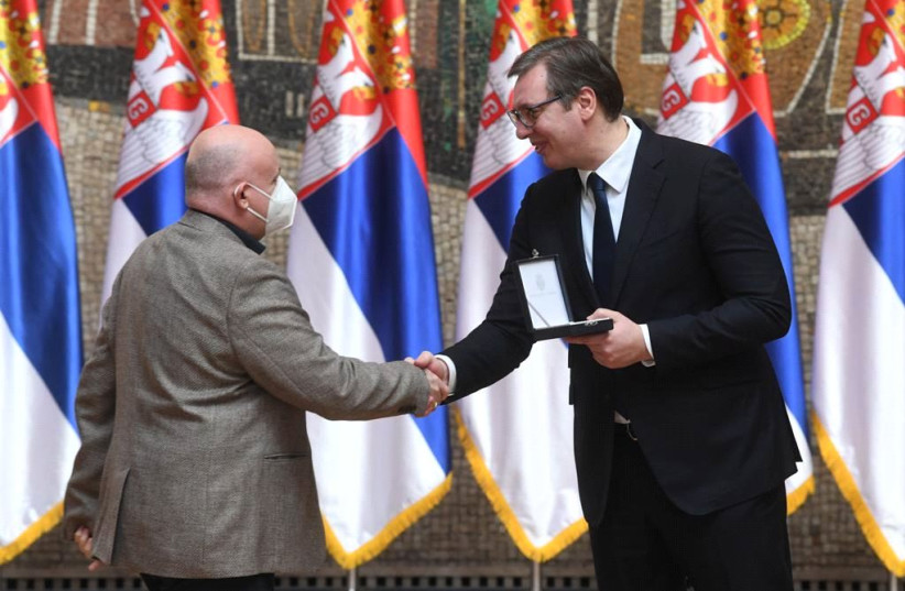 Serbian President Aleksandar Vučić bestowing an award to President of the UNS Vladimir Radomirović on Michael Freund's behalf. (photo credit: DIMITRIJE GOLL (OFFICE OF THE PRESIDENT OF SERBIA))