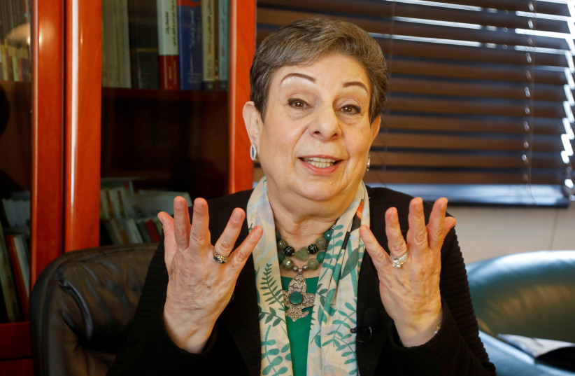 Palestinian politician Hanan Ashrawi gestures during a February 3 2021 interview with Reuter in the West-Bank city of Ramallah (photo credit: RANEEN SAWAFTA/ REUTERS)