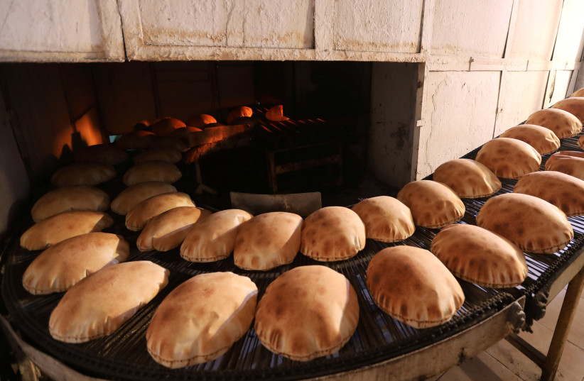 Freshly baked bread cools at a bakery in Beirut, Lebanon June 30, 2020. (photo credit: MOHAMED AZAKIR / REUTERS)