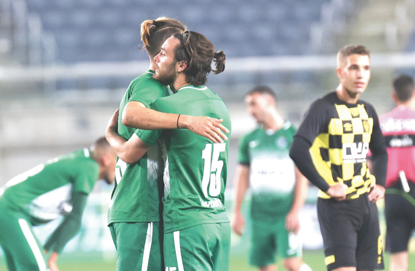 MACCABI HAIFA players celebrate on the pitch at the end of the Greens 3-0 victory over Beitar Jerusalem in Israel Premier League action at Teddy Stadium. (photo credit: DANNY MARON)