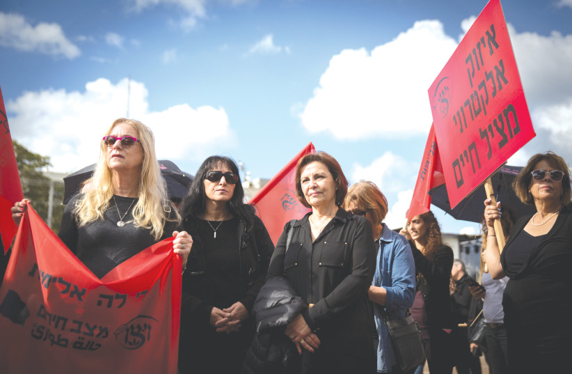 A GROUP of women – one holding a sign that says 'Electronic bracelets save lives' – participate in nationwide strike protesting violence against women, in Tel Aviv in 2018. (photo credit: MIRIAM ALSTER/FLASH90)