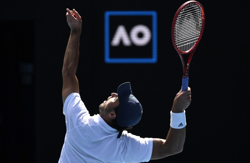 Aslan Karatsev in action during his quarter final match against Bulgaria's Grigor Dimitrov  (photo credit: JAIMI JOY/REUTERS)