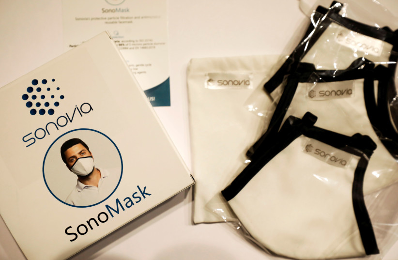 Packaging of Israel's Sonovia Ltd's washable and reusable antiviral masks, which the company says can help stop the spread of the coronavirus disease (COVID-19), is displayed along with the masks at the company laboratory, in Ramat Gan, Israel May 17, 2020.  (photo credit: AMIR COHEN/REUTERS)