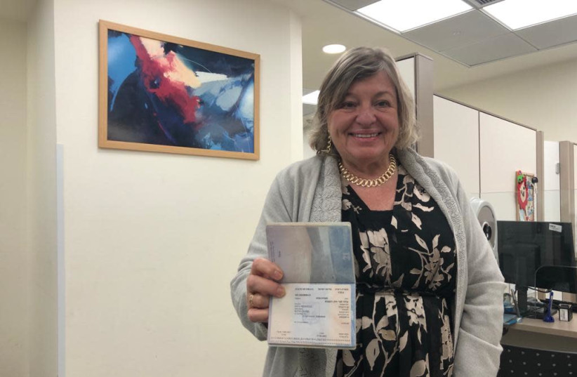 Prof. Ruth Katz shows off her brand new Israeli citizen ID having obtained it on Wednesday after a two year struggle with the Interior Ministry. (photo credit: COURTESY PROF. RUTH KATZ)