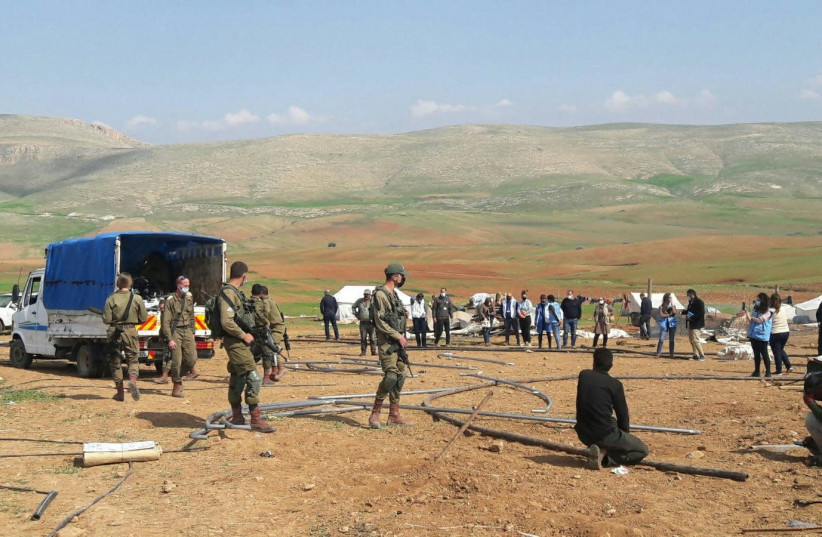 The Civil Administration confiscates tents at the site of the contested Humsa village in the Jordan Valley. (photo credit: AREF DARAGHMEH/B'TSELEM)