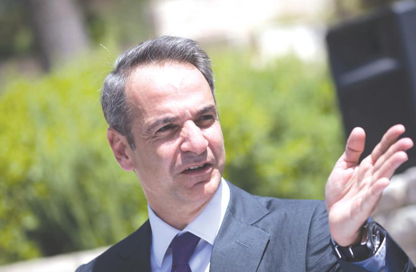 GREEK PRIME MINISTER Kyriakos Mitsotakis waves during a visit to Israel in June. (photo credit: YONATAN SINDEL/FLASH90)