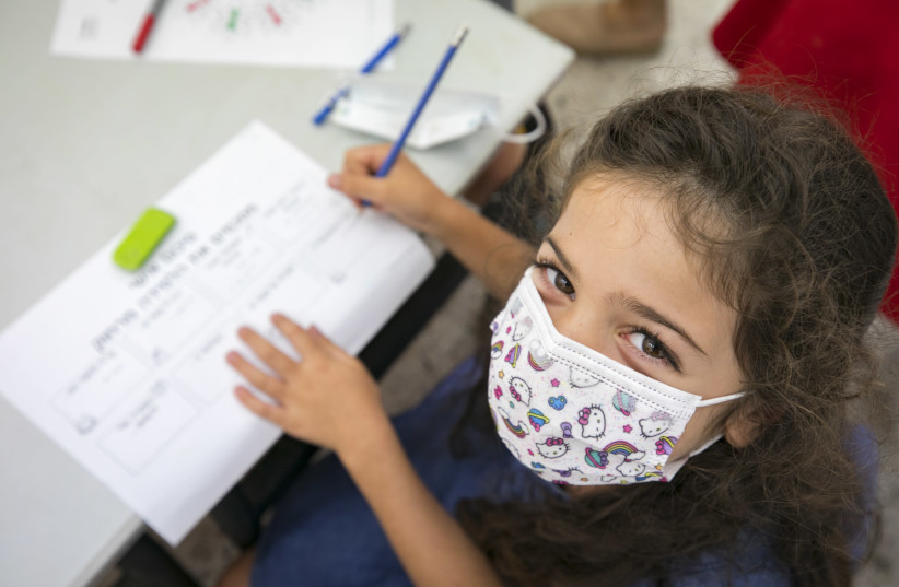 The program helps children fill their lonely pandemic days in a constructive manner (photo credit: OLIVIER FITOUSSI/FLASH90)