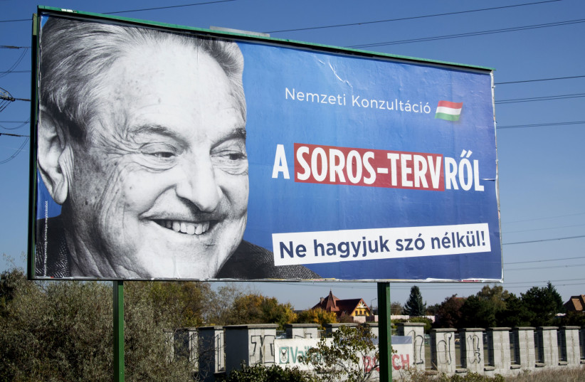 "This 2017 billboard in Budapest was part of a Hungarian government campaign to ""demonize George Soros,"" the report said. (photo credit: ATTILA KISBENEDEK / AFP)"