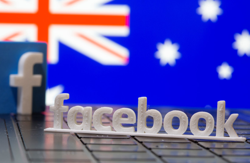A 3D printed Facebook logo is seen in front of displayed Australia's flag in this illustration photo taken February 18, 2021 (photo credit: REUTERS/DADO RUVIC/ILLUSTRATION)