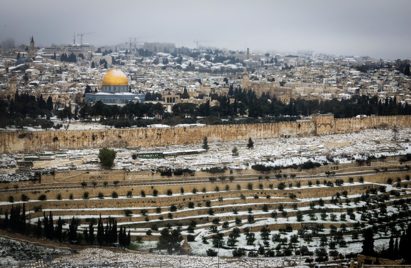 Snow view of the old city in Jerusalem, February 18, 2021 (photo credit: MARC ISRAEL SELLEM)
