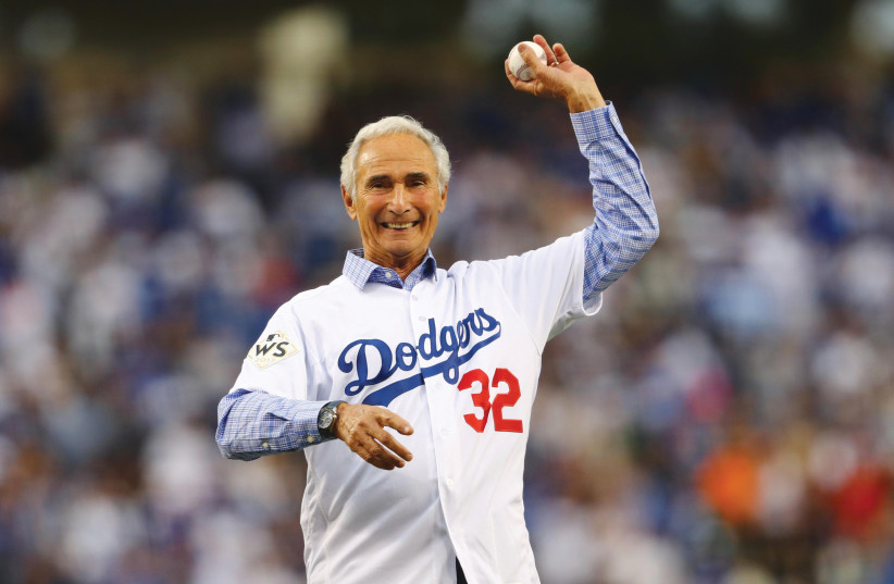 LEGENDARY LA Dodgers pitcher Sandy Koufax throws out the first pitch at the 2017 World Series. Derfner says his friends would not have loved the Jewish Koufax had he not been a star. (photo credit: TIM BRADBURY/POOL PHOTO VIA USA TODAY SPORTS)