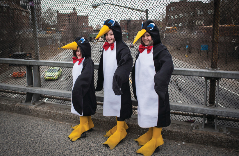 GIRL OR penguin? in costume on an overpass on Purim in South Williamsburg, New York, 2014. (photo credit: ANDREW KELLY / REUTERS)
